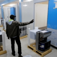 Workers prepare new cold rooms to store Senegal's stock of vaccines, including COVID-19 vaccines, at the Fann Hospital in Dakar on Jan. 11. | REUTERS