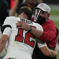 Tampa Bay head coach Bruce Arians hugs quarterback Tom Brady after  their game against the Raiders in Las Vegas on Oct. 25, 2020. | USA TODAY / VIA REUTERS