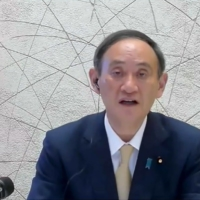 Prime Minister Yoshihide Suga addresses an all-virtual World Economic Forum, which usually takes place in Davos, Switzerland, on Friday. | WORLD ECONOMIC FORUM / VIA AFP-JIJI