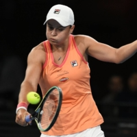 Ash Barty hits a return against Simona Halep during their exhibition match in Adelaide, Australia, on Friday. | AFP-JIJI
