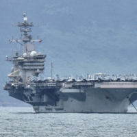 U.S. slams Chinese warplanes' flights, but says carrier wasn't at risk