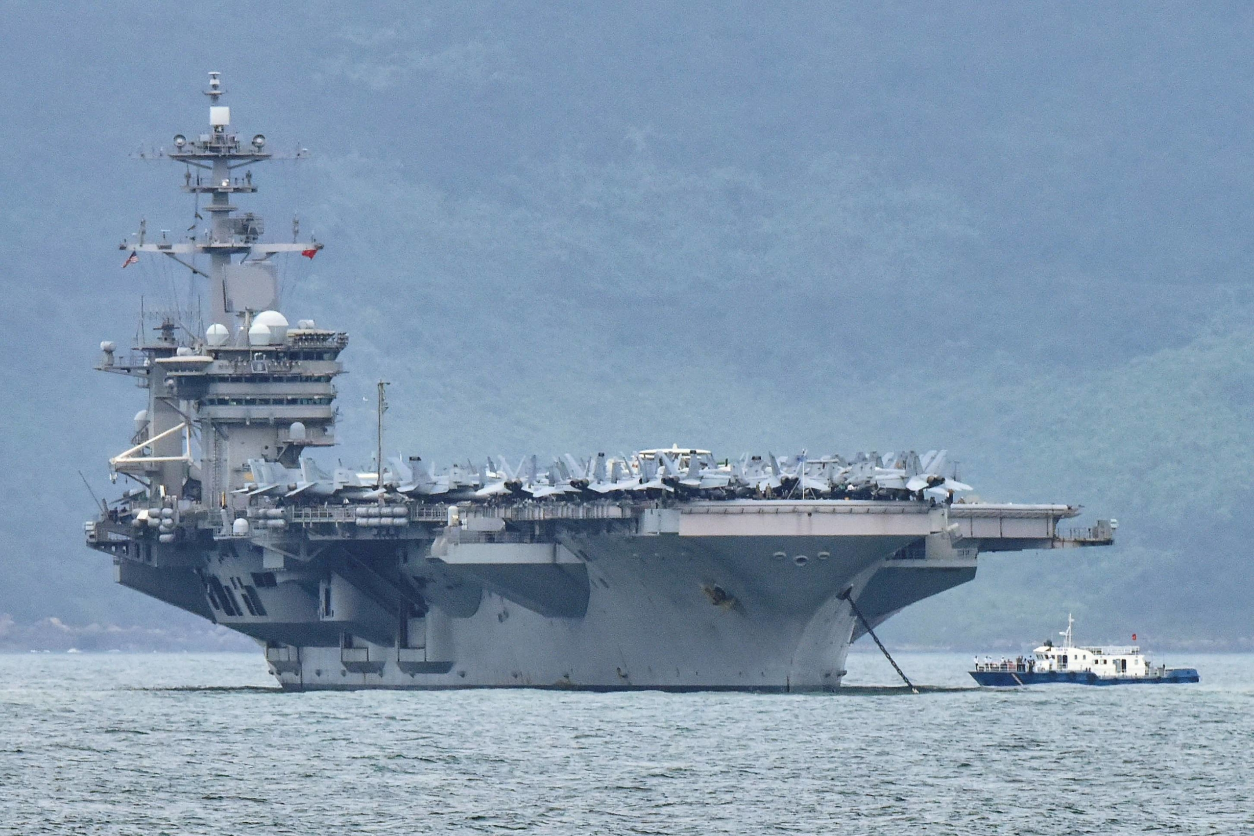 The USS Theodore Roosevelt aircraft carrier enters the port in Da Nang, Vietnam, in March last year. | REUTERS