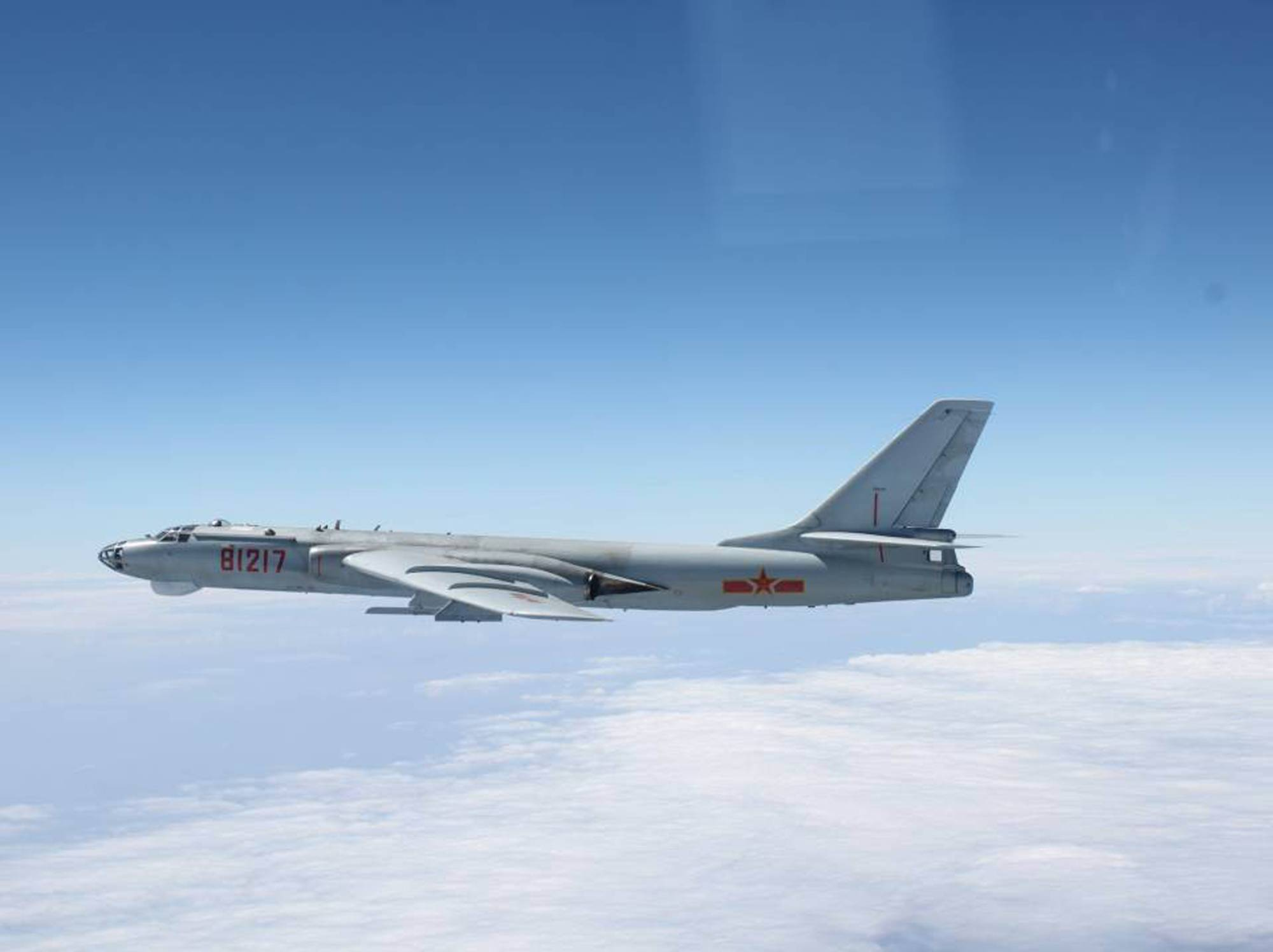 A Chinese H-6 bomber flies through airspace between Okinawa Prefecture's main island and the smaller Miyako Island in October 2013. | JAPANESE DEFENSE MINISTRY / VIA REUTERS
