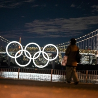The Olympic rings are lit up on the Odaiba waterfront in Tokyo.  | AFP-JIJI