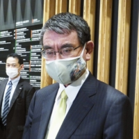 Taro Kono, minister in charge of vaccine rollout, speaks to reporters in Tokyo on Thursday. | KYODO