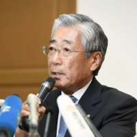 Tsunekazu Takeda, then president of the Japanese Olympic Committee, speaks at a news conference in Tokyo in January 2019 over bribery allegations over the capital's Olympic bid.  | KYODO