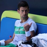 Serbia's Novak Djokovic takes a rest during a training session in Melbourne on Sunday ahead of the Australian Open, which begins on Feb. 8.  | AFP-JIJI