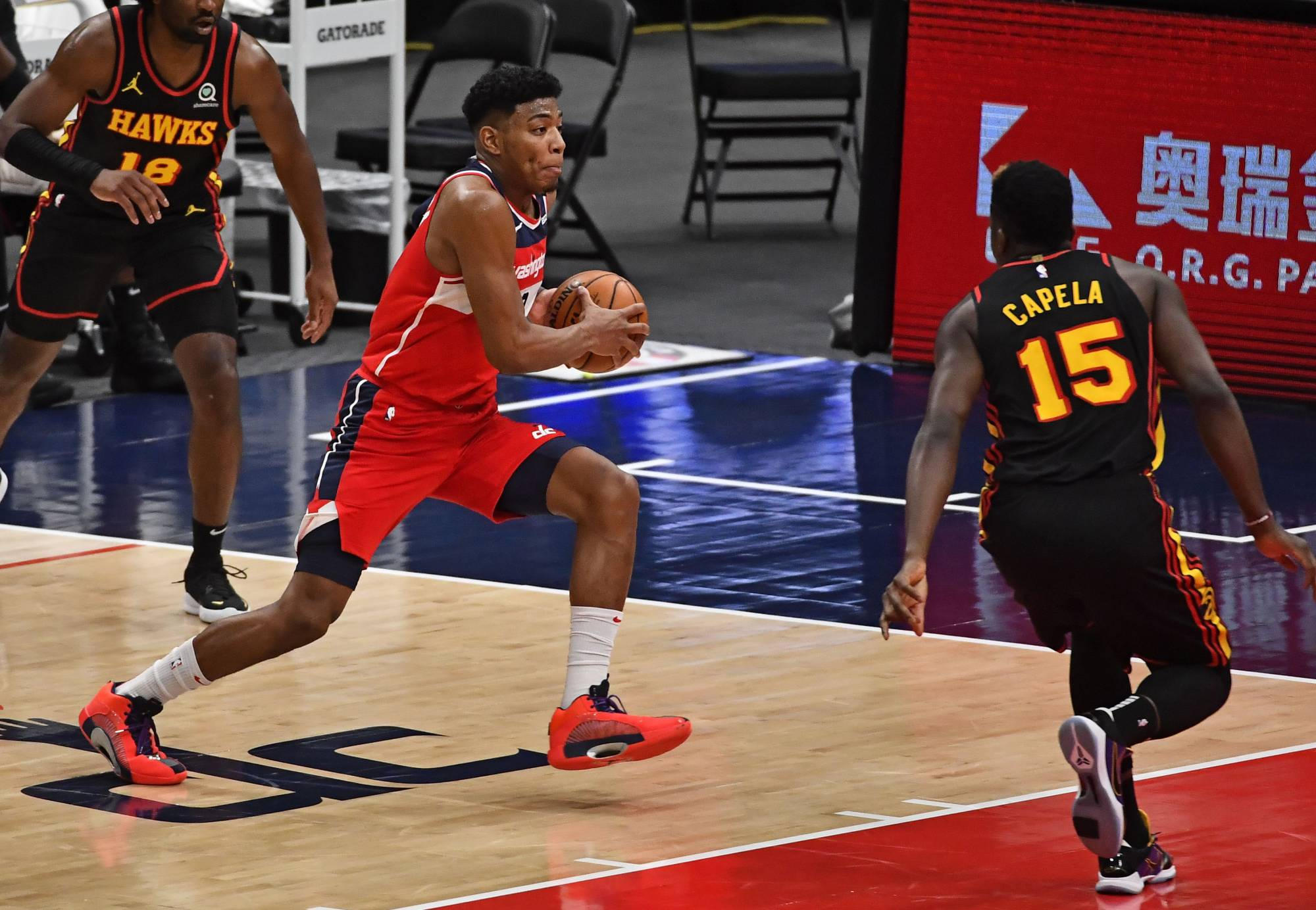 Washington Wizards forward Rui Hachimura drives to the basket against Atlanta Hawks center Clint Capela during the second quarter at Capital One Arena in Washington on Friday.   USA TODAY / VIA REUTERS