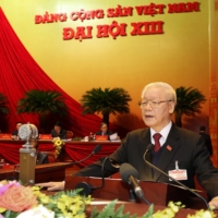 Vietnam Communist Party General-Secretary Nguyen Phu Trong addresses the opening session of the party's 13th National Congress at the National Convention Center in Hanoi on Tuesday. | VIETNAM NEWS AGENCY / VIA AFP-JIJI