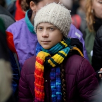 Swedish climate activist Greta Thunberg takes part in the Europe Climate Strike rally in Brussels last March. | REUTERS