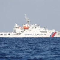 A China Coast Guard vessel near the disputed Scarborough Shoal in the South China Sea in April 2017 | REUTERS