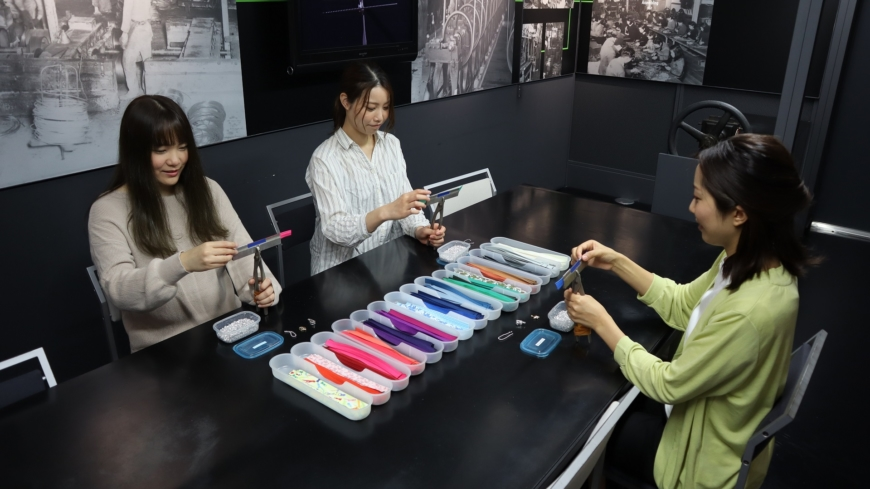 Visitors can join workshops to make their own zippers; it's more difficult than it looks! | YKK GROUP