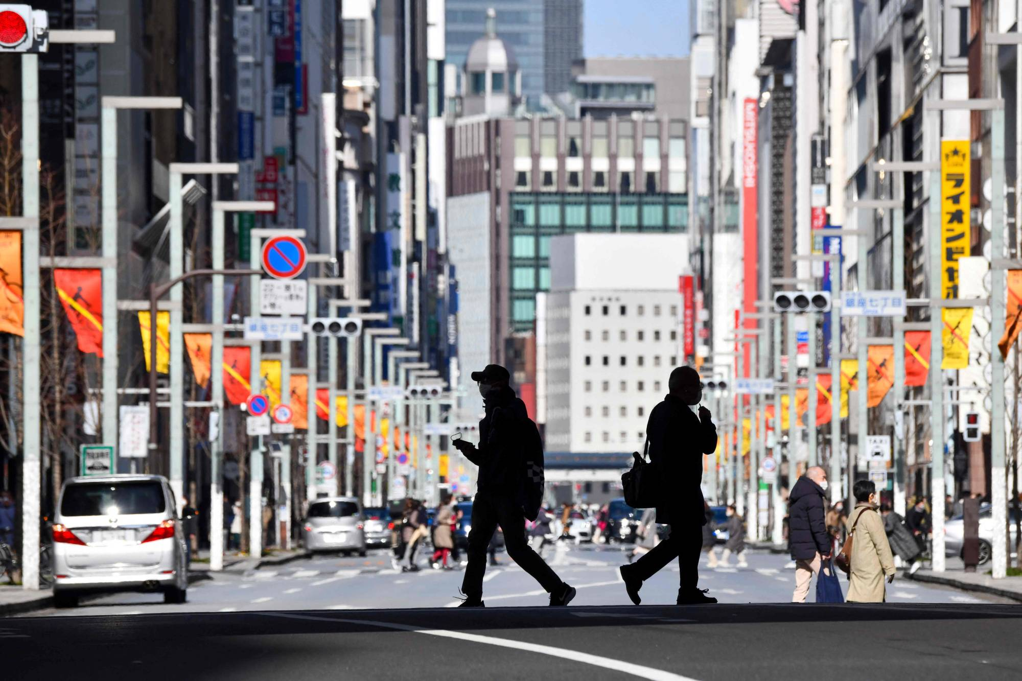 Pedestrians cross a street in Tokyo's Ginza shopping district over the weekend. | AFP-JIJI