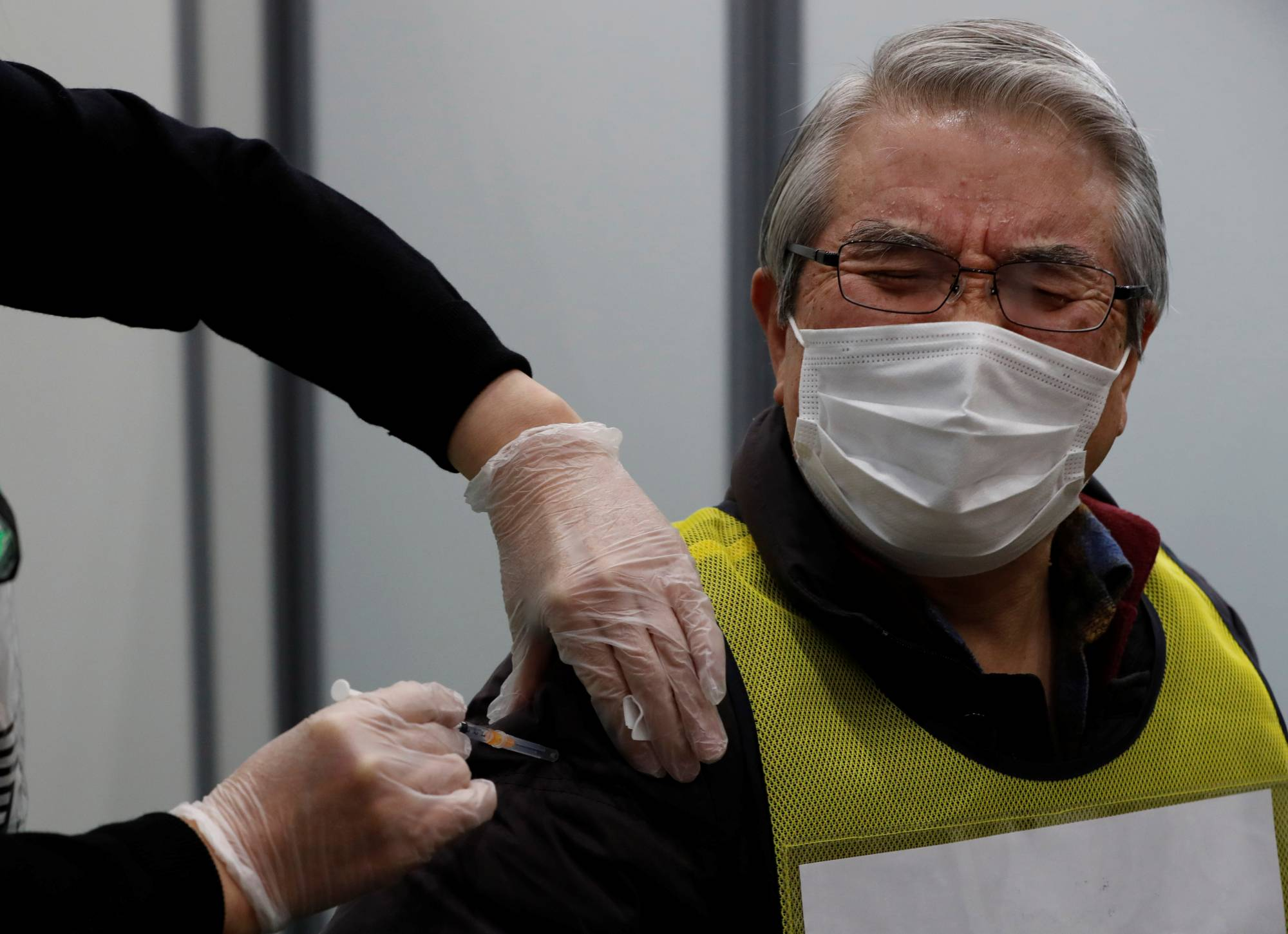 While some other countries' COVID-19 vaccination programs are well underway, Japan has so far only seen a handful of its population receive a dummy dose in a mock inoculation event. | REUTERS