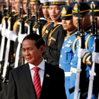 Myanmar President Win Myint reviews an honor guard at the Government House in Bangkok during a 2018 visit.  | REUTERS