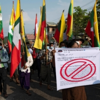 Supporters of Myanmar's military take part in a protest against the Union Election Commission, the elected government and foreign embassies in Yangon on Saturday.  | REUTERS