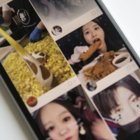 Kuaishou, which means 'fast hand,' is one of China's biggest internet success stories of the past decade, part of a generation of startups that thrived with backing from Tencent Holdings Ltd. | BLOOMBERG