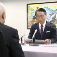 Takahama Mayor Yutaka Nose announces his approval for the restart of the Nos. 1 and 2 reactors at the Takahama Nuclear Power Plant before Tokuro Uwao, chairman of the municipal assembly in Takahama, Fukui Prefecture, on Monday. | KYODO