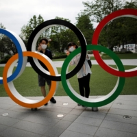 Tokyo 2020 organizers can't pin Olympic hopes on vaccines alone, experts warn
