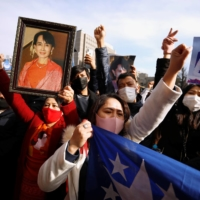 A group of Myanmar activists protest outside the United Nations University building in Tokyo on Monday following a military coup in the country. | REUTERS