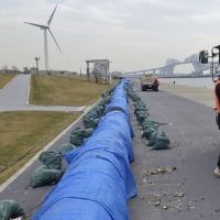 Wave dispersion devices for the Tokyo Olympic rowing and canoe venue, Sea Forest Waterway, have been brought onto dry land for storage. | TOKYO METROPOLITAN GOVERNMENT / VIA KYODO