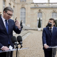 Serbian President Aleksandar Vucic (left) and French President Emmanuel Macron speak to the press before a meeting at the Elysee Presidential Palace in Paris on Monday.  | AFP-JIJI