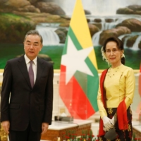 China State Councillor and Foreign Minister Wang Yi is welcomed by and Myanmar State Counsellor Aung San Suu Kyi in Naypyitaw, Myanmar, on Jan. 11. | MYANMAR PRESIDENT OFFICE / VIA REUTERS