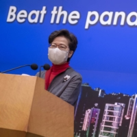 Hong Kong threatens to knock down doors to force COVID-19 tests