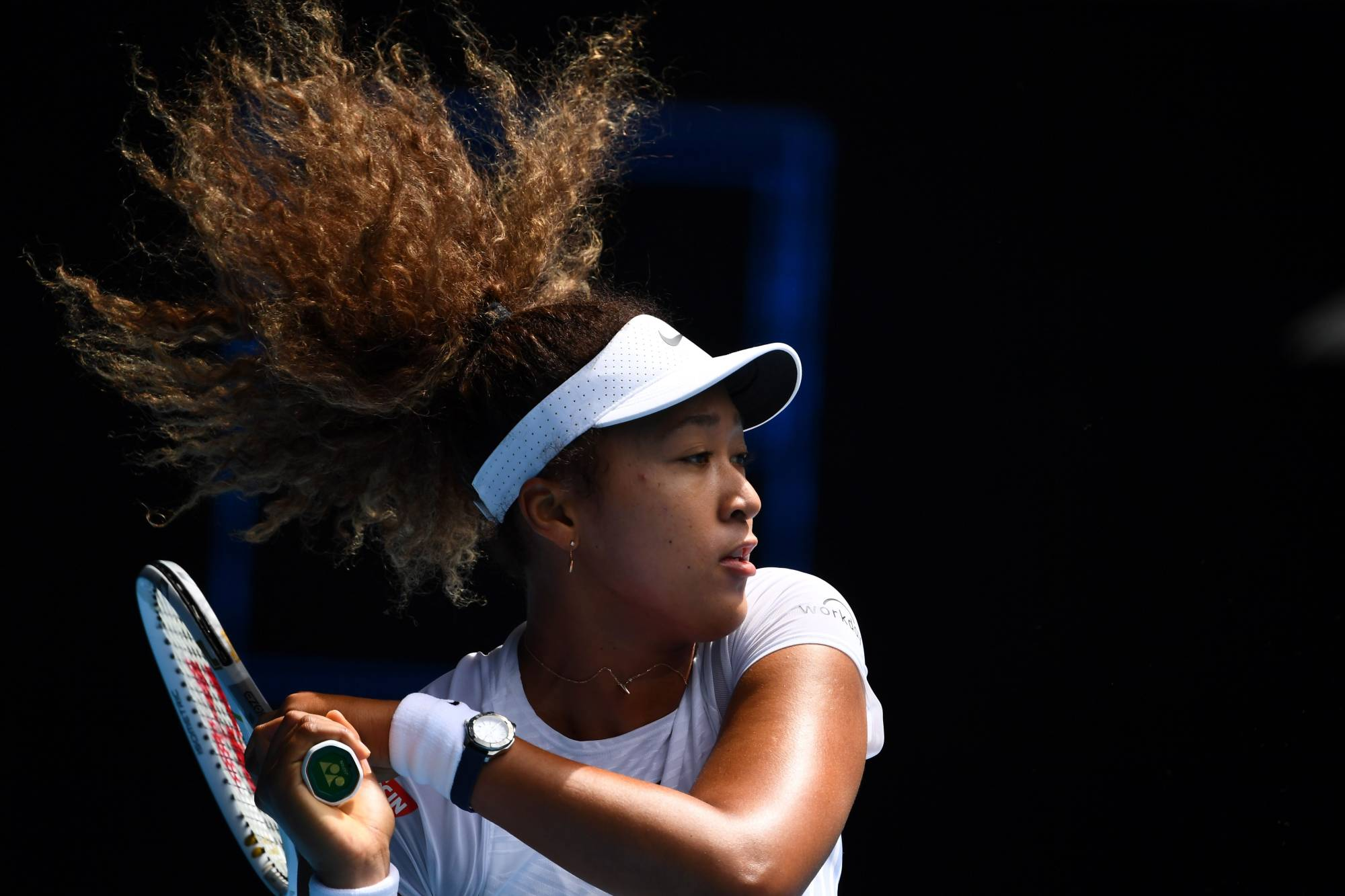 Naomi Osaka hits a return against France's Alize Cornet during their Gippsland Trophy women's singles tennis match in Melbourne on Tuesday.  | AFP-JIJI