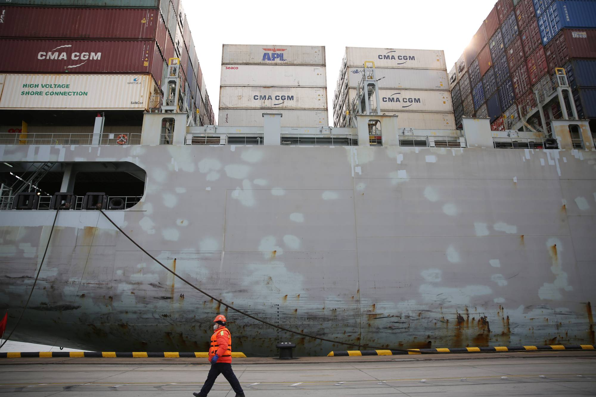 Refrigerated boxes are piling up at ports in China and exacerbating a global container crunch, as workers comply with strict COVID-19 testing procedures and disinfect meat and seafood products after frozen-food imports were blamed for the spread of the novel coronavirus. | CNSPHOTO / VIA REUTERS