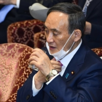 Prime Minister Yoshihide Suga attends a Lower House budget committee session at the Diet in Tokyo on Jan. 22. | AFP-JIJI