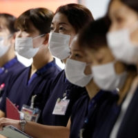 Narita International Airport PCR Center, operated by Nippon Medical School Foundation, opened in late 2020 to offer tests to people needing proof of their negative infection status in other nations. | REUTERS