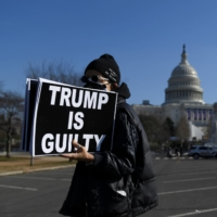 A protester demonstrates against then-U.S President Donald Trump near the U.S. Capitol building on Jan. 13 in Washington. | REUTERS