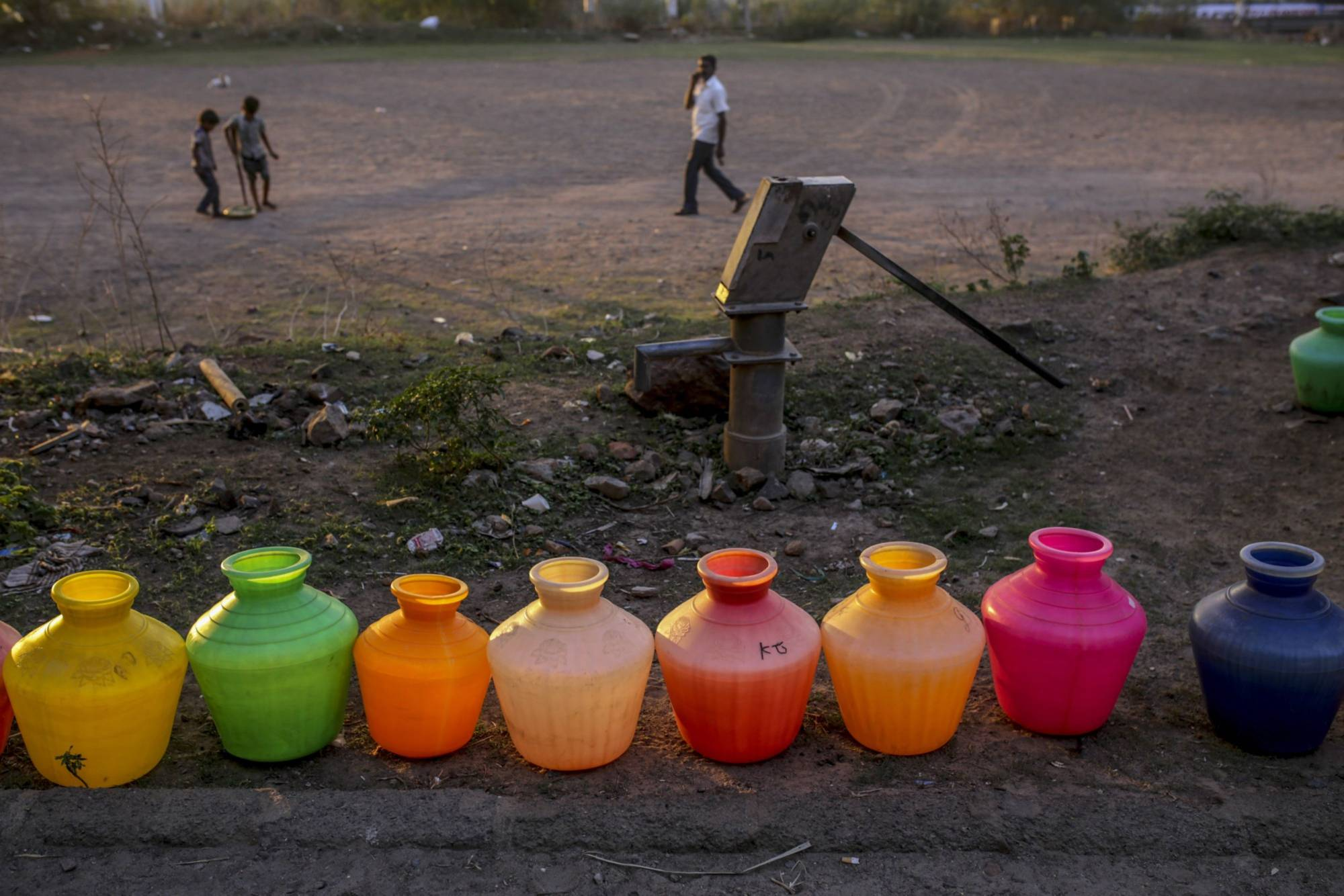 Empty water pots, left to be refilled by a water truck, line a residential street in Chennai, on July 4, 2019. | BLOOMBERG