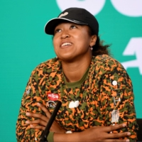 Naomi Osaka speaks during a news conference in Melbourne on Wednesday. | AFP PHOTO / VINCE CALIGIURI / TENNIS AUSTRALIA