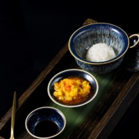 Suzhou style: A golden-orange mixture of roe, milt, tomalley and crabmeat pairs with a small serving of long-grain rice. | COURTESY OF XIE WANG FU