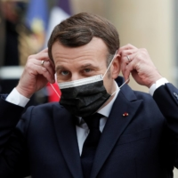 French President Emmanuel Macron is calling on China to be more transparent about its vaccines.  | REUTERS