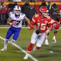 Chiefs quarterback Patrick Mahomes scrambles during the AFC title game against the Bills in Kansas City, Missouri, on Jan. 24. | USA TODAY / VIA REUTERS