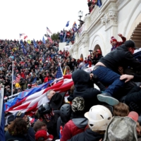 Rioters backing then-President Donald Trump storm into the U.S. Capitol in Washington on Jan. 6.  | REUTERS