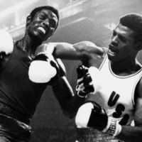 Leon Spinks (right) punches Cuba's Sixto Soria in the 81-kg final of the 1976 Summer Olympics in Montreal. | AFP-JIJI