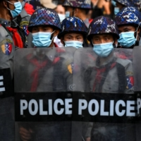 Riot police block a street in Yangon on Saturday as protesters gather for a demonstration against the military coup.  | AFP-JIJI
