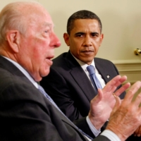 Then-U.S. President Barack Obama listens as former U.S. Secretary of State George Shultz speaks in the Oval Office of the White House in Washington in May 2009. | REUTERS