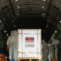 A shipment of 600,000 doses COVID-19 vaccines donated by China arrives at Phnom Penh International Airport the Cambodian capital on Sunday. | REUTERS