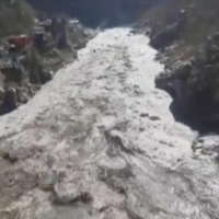 Floodwaters hit the Chamoli area of India's Uttarakhand state on Sunday in this image taken from video after a piece of Himalayan glacier fell into a river.  | ANI / REUTERS TV / VIA REUTERS