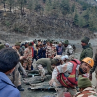 Members of the Indo-Tibetan Border Police (ITBP) tend to people rescued after a Himalayan glacier broke and swept away a small hydroelectric dam, in the Chormi area of India's  Uttarakhand state on Sunday.  | REUTERS
