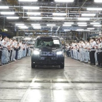 Workers at a Toyota Motor Corp. subsidiary's Higashi-Fuji factory watch the last car manufactured there roll out in December. | CHUNICHI SHIMBUN