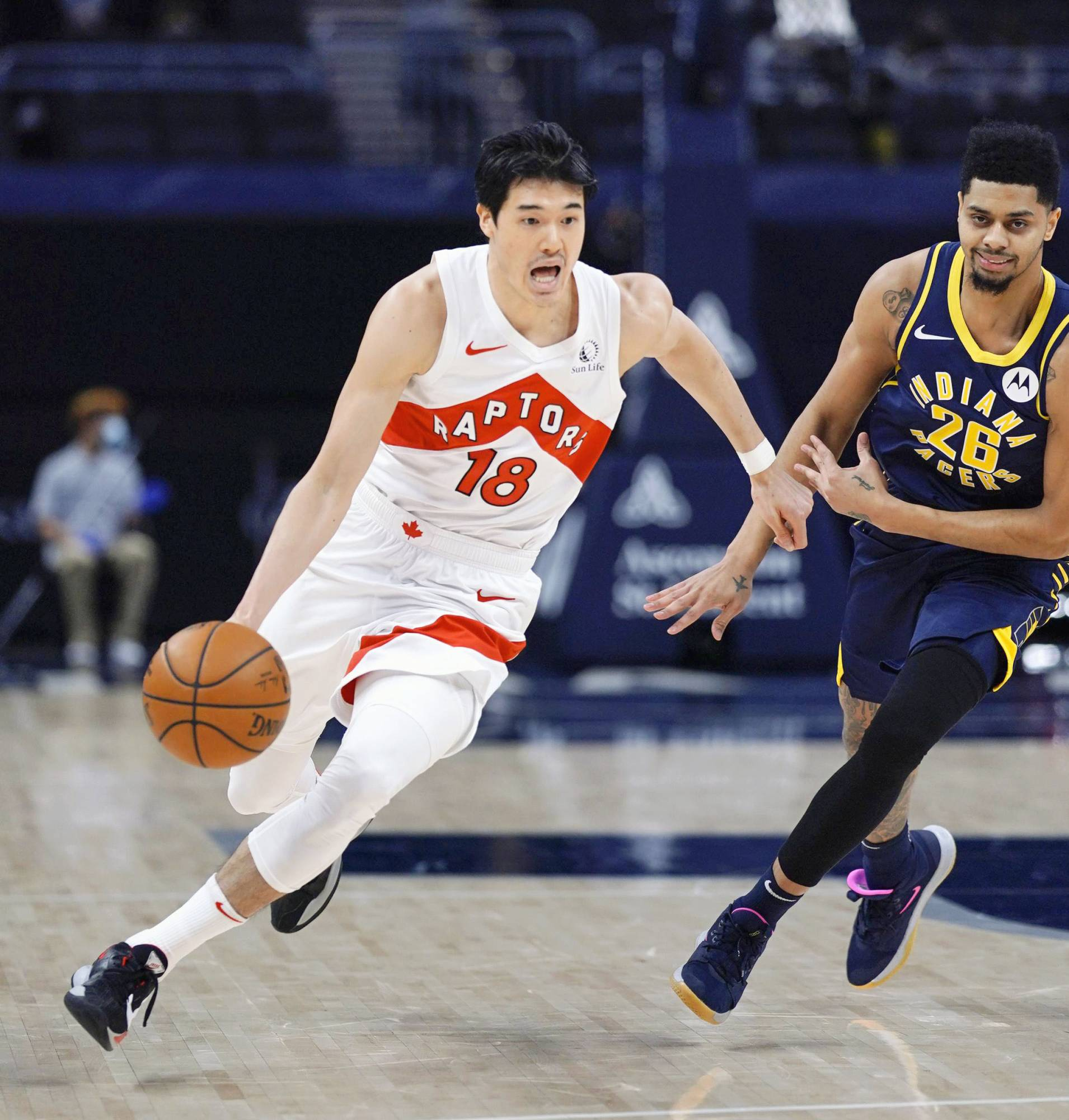 Yuta Watanabe of the Toronto Raptors drives past a defender during a game against the Indiana Pacers on Jan. 26. | NBAE / GETTY IMAGES / VIA KYODO