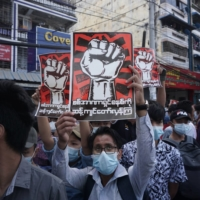 Protesters hold signs denouncing the military during a demonstration against the coup in Yangon, Myanmar, on Monday. | AFP-JIJI