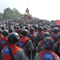 A phalanx of riot police face off with protesters during a demonstration against the military coup at the monument of Gen. Aung San, the late father of Aung San Suu Kyi, in Naypyitaw, Myanmar, on Monday. | AFP-JIJI