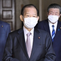 Liberal Democratic Party Secretary-General Toshihiro Nikai backed Tokyo Olympic chief Yoshiro Mori to stay on despite a wave of criticism over his sexist remarks toward women. | KYODO